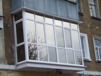 Остекление балконов и лоджий с тонированным стеклом в тюмени.